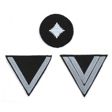 Privates' sleeve insignia chevrons on black