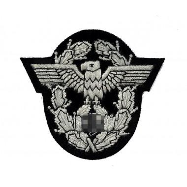 Eagle in a wreath police insignia